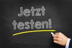 Hand writing jetzt testen (test it now) Stock Image