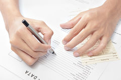 Hand writing job application Stock Photo