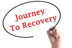 Hand writing Journey To Recovery on transparent board.  Stock Photography