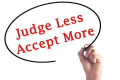 Hand writing Judge Less Accept More on transparent board Stock Photos