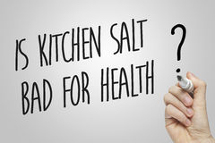 Hand writing is kitchen salt bad for health Stock Photography