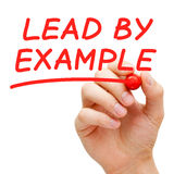 Lead By Example. Hand writing Lead By Example with red marker on transparent wipe board Royalty Free Stock Photography