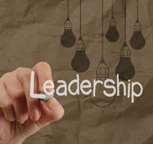 Hand writing leadership with crumpled recycle paper. Background as concept Royalty Free Stock Photo