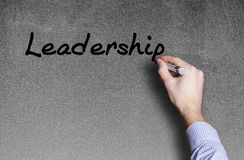 Hand writing a leadership word Royalty Free Stock Image