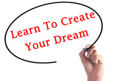 Hand writing Learn To Create Your Dream on transparent board.  Stock Photo