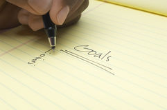 Hand Writing List Of goals On Notepad Stock Photos
