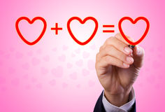 Hand writing love mathematical equation  of heart Stock Image