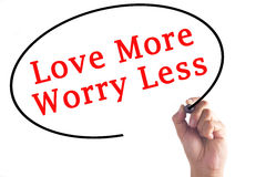 Hand writing Love More Worry Less on transparent board.  Royalty Free Stock Photos
