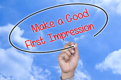 Hand writing Make a Good First Impression Royalty Free Stock Photo