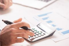 Calculate. Hand Writing Make Note And Calculate Stock Photo
