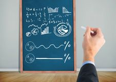 Hand writing math diagrams on blackboard Stock Photography