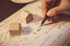 Hand writing math equation classic formula vintage. Tone royalty free stock image