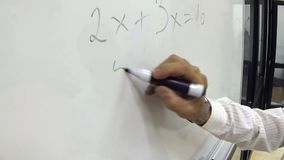 Hand Writing Math Formula for Elementary School on a Whiteboard stock video