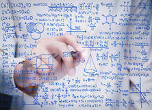 Hand writing math formula. On glass board stock photo