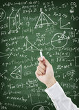 Hand writing maths formula on chalkboard Stock Photos