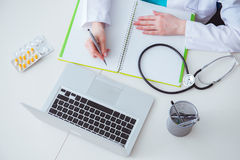 The hand writing medical prescription in computer royalty free stock photography