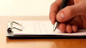 Hand writing a message stock footage