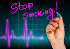 Hand writing message STOP SMOKING Royalty Free Stock Photography