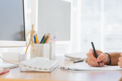 Hand writing in a modern office Stock Images