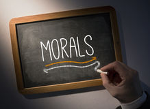 Hand writing Morals on chalkboard Royalty Free Stock Photo