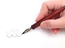 Hand writing with a nib. Over white Stock Photography