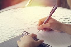 Hand writing on note paper. In morning at table Royalty Free Stock Photos