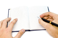 Hand writing on a notebook Stock Photos