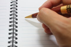Hand writing on notebook Stock Photography