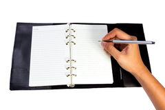 Hand writing in notebook Royalty Free Stock Photo