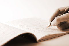 Hand writing in notebook Royalty Free Stock Images