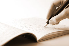 Hand writing in notebook Stock Images