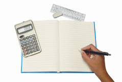 Hand writing on notebook with Calculator Stock Photography