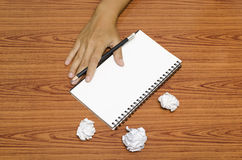 Hand writing on notebook with crumpled paper Stock Photography