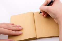 Hand writing on notebook Royalty Free Stock Photography