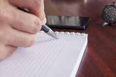 Hand writing in a notebook royalty free stock photo