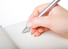 Hand writing in a notebook Stock Photography