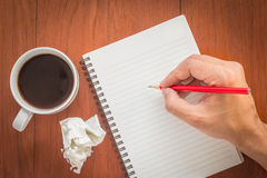 Hand writing on notebook with pencil. Royalty Free Stock Photos
