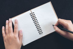 Hand writing on notebook Royalty Free Stock Photo