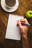 Hand writing on the notepad Royalty Free Stock Photos