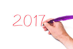 2017. Hand writing numbers purple pen on white background Royalty Free Stock Photography