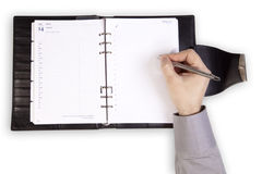Hand writing on a organizer Stock Photography