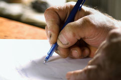 Hand Writing In Pad Stock Image