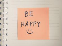 Hand writing on paper. Be happy hand writing and hand draw smiley message on paper, colored filter effect Royalty Free Stock Images