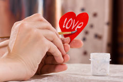 Hand writing on the paper heart for Valentine's day Royalty Free Stock Photos
