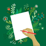 Hand writing on the paper with a pencil and flowers Royalty Free Stock Image