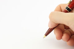 Hand writing with a pen Stock Image