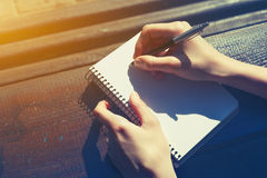 Hand writing with pen Royalty Free Stock Images