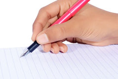 Hand writing with pen isolated. On white background Royalty Free Stock Image