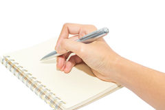 Hand writing with pen isolated on white Stock Images