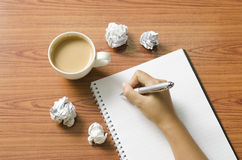 Hand writing with pen on notebook Royalty Free Stock Images